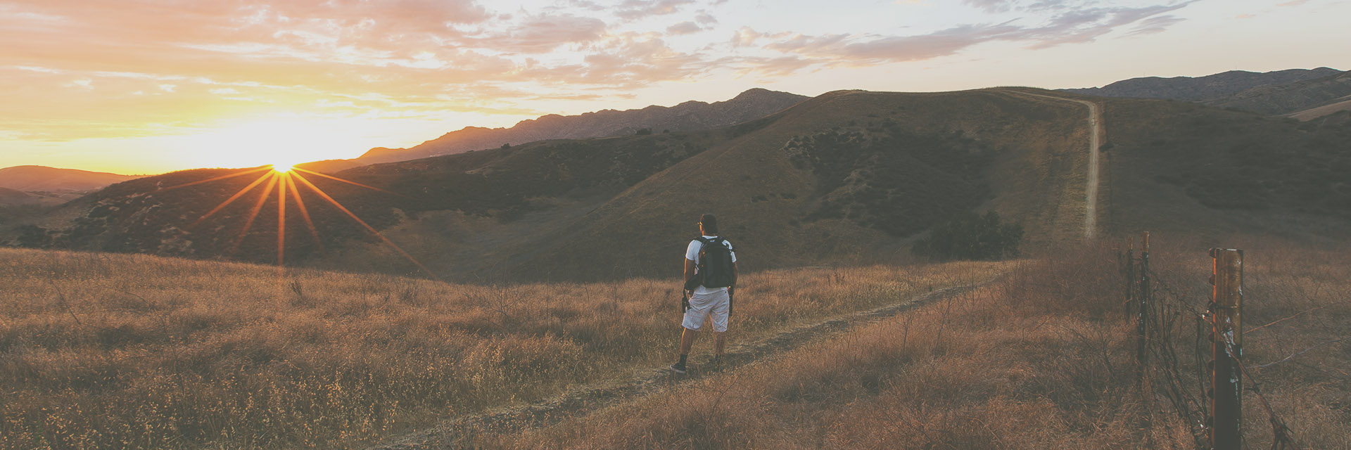 Young man looks out the vast amount of untouched landscapes near Vista Canyon