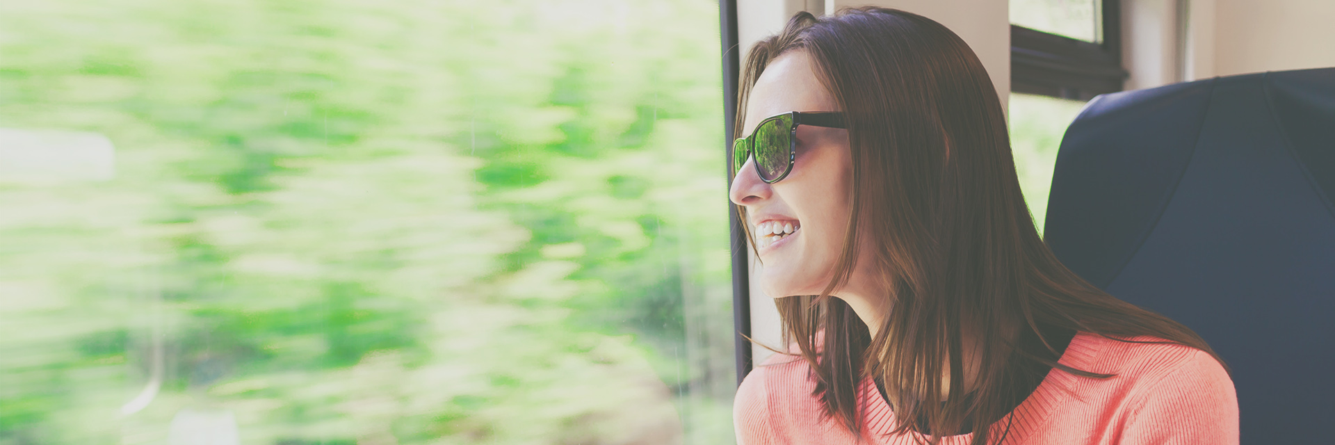 Young woman looking out the window during a train ride